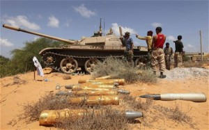 Anti-Gaddafi forces place tanks in position in Om El Khanfousa, east of Sirte, after liberating the area from Gaddafi's forces Photo: REUTERS/Esam Al-Fetori