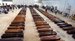October 5, 2013: Coffins are laid out in a hangar at Lampedusa airport after a boat packed with migrants sank, killing more than 360 people(Alberto Pizzoli/AFP)